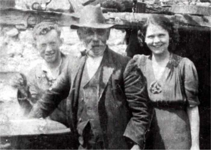 Granda Boyle with Peter and Florrie, at the potato boiler, about 1940